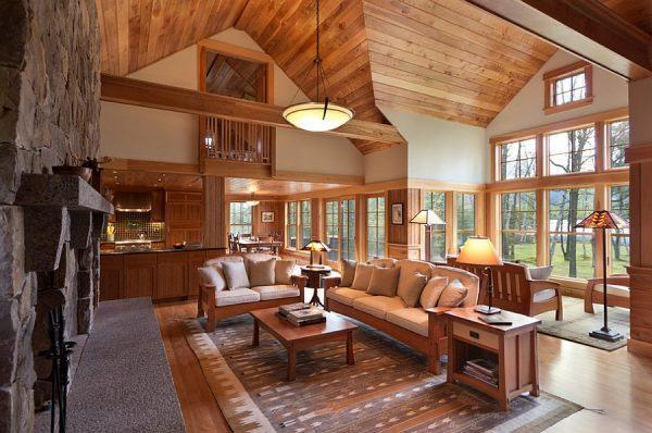 Rustic-living-room-in-wood-and-stone-with-lovely-views-outside