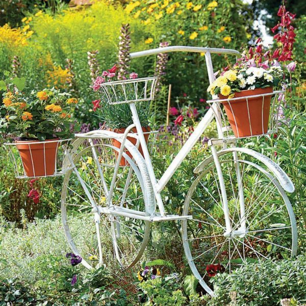 bicycle planter stands outdoors