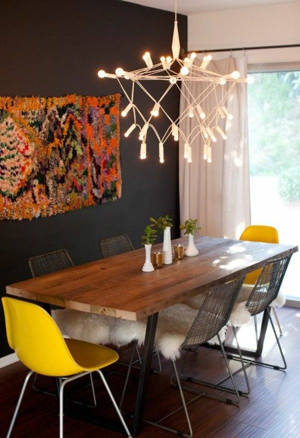 dining room table with different colored chairs