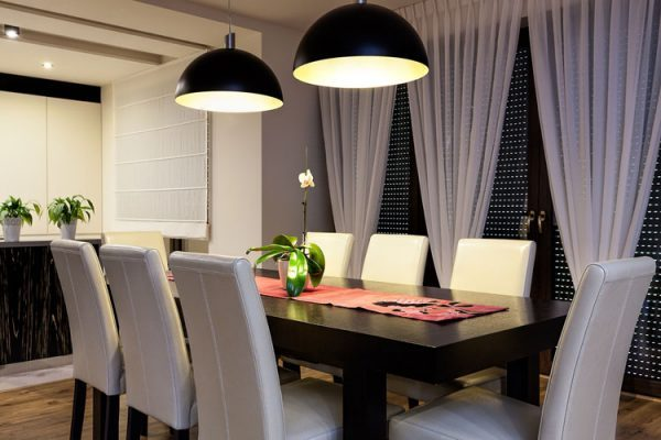 hanging light fixture over dining room table