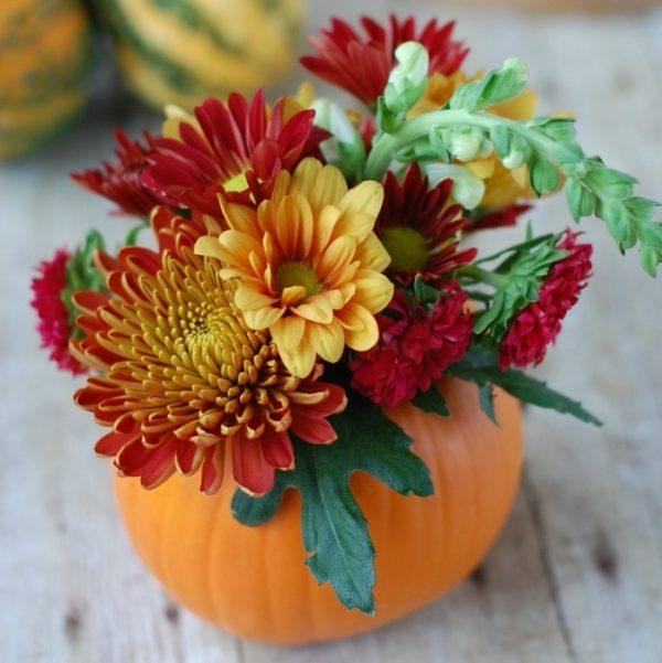 flowers in pumpkins centerpieces