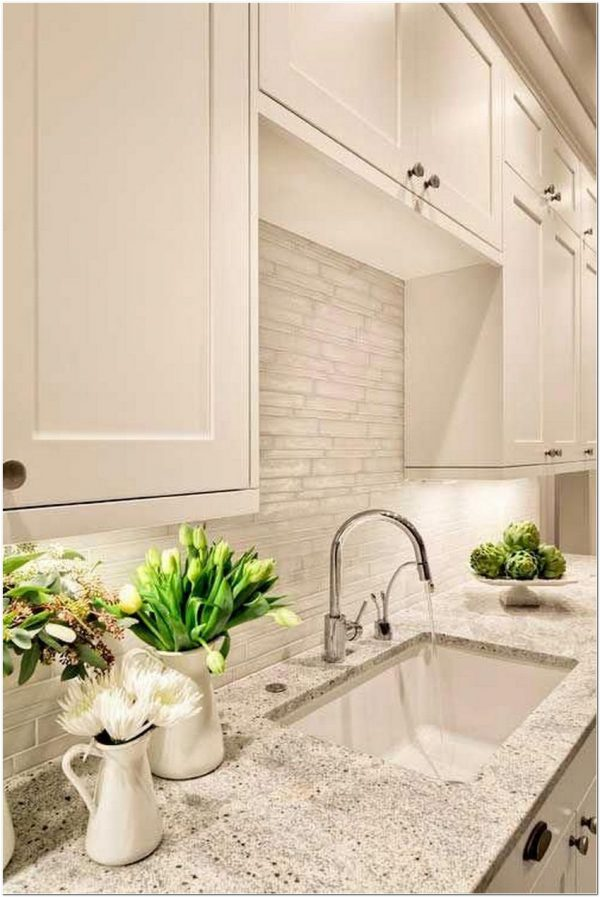 kashmir white granite with white cabinets