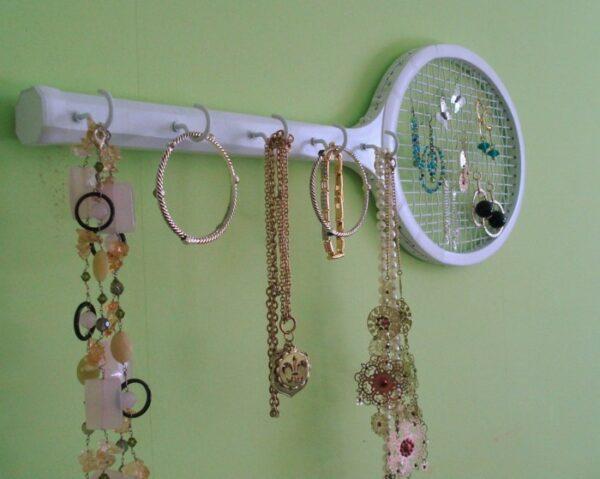 vintage tennis rackets on wall