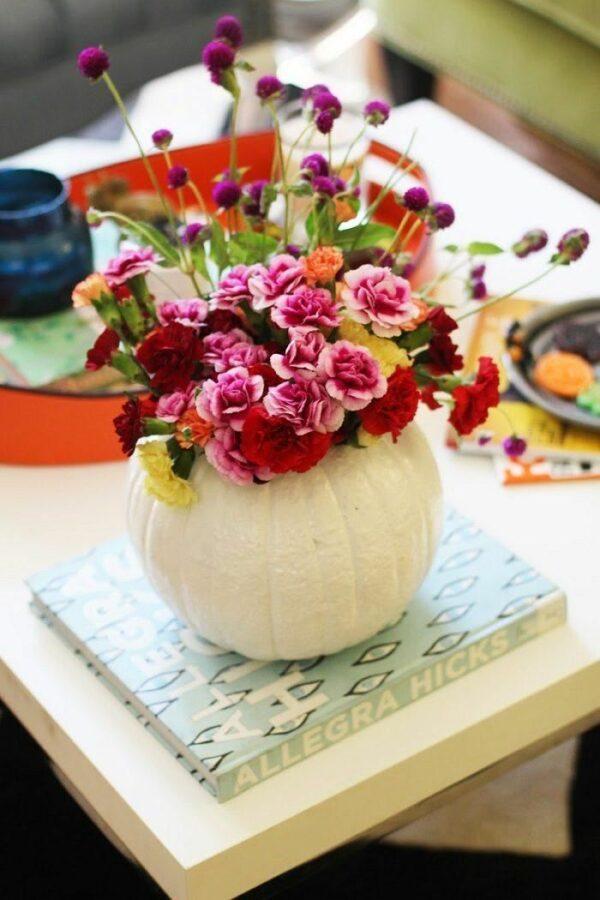 flowers in a pumpkin centerpiece